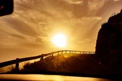 Estrada adiante e o por do sol Foto de Stock Royalty Free