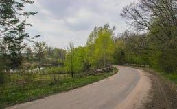 Estrada asfaltada má Foto de Stock