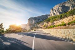 Estrada asfaltada no verão no nascer do sol Imagem de Stock Royalty Free