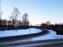 Estrada através da neve Imagens de Stock Royalty Free
