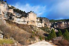 Estrada através das rochas Foto de Stock