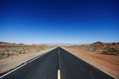 Estrada através do parque Fotografia de Stock