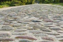 A estrada cobbled velha Imagem de Stock Royalty Free