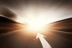 Estrada com seta Imagens de Stock