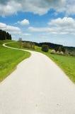 Estrada curvada no país Imagens de Stock Royalty Free