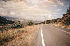 Estrada da curva em Grécia Fotos de Stock