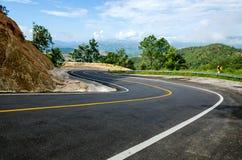 Estrada da curva no monte Fotos de Stock