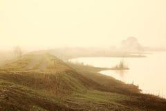 Estrada da mola perto do lago Imagens de Stock Royalty Free