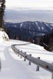 Estrada da montanha do inverno Foto de Stock Royalty Free