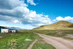 Estrada da montanha, Ketmen Ridge, Cazaquistão Fotos de Stock