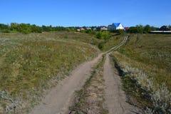 Estrada da paisagem à casa Imagens de Stock Royalty Free