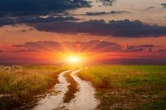 Estrada da rotina ao por do sol Imagem de Stock Royalty Free