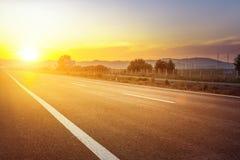 Estrada de cidade do por do sol Imagem de Stock