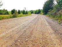 Estrada de terra do campo e cerca de madeira fotografia de stock royalty free