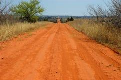 Estrada de terra vermelha Imagens de Stock