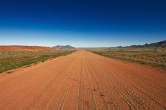 Estrada do deserto a em nenhuma parte Fotos de Stock Royalty Free