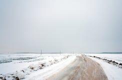 Estrada do inverno do país Fotos de Stock
