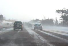 Estrada do inverno durante a tempestade da neve Fotografia de Stock