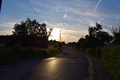 Estrada do por do sol Imagens de Stock Royalty Free