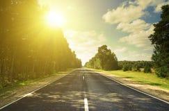 Estrada do por do sol nos montes russian Imagens de Stock Royalty Free