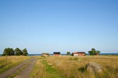 Estrada e cabines velhas Fotos de Stock Royalty Free