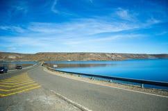 Estrada e lago Imagem de Stock