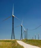 Estrada e moinhos de vento Fotografia de Stock
