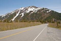 Estrada e montanha Fotografia de Stock Royalty Free