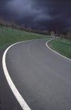 Estrada e nuvens Fotografia de Stock