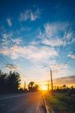 Estrada e o céu do por do sol Imagens de Stock Royalty Free
