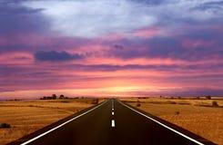 Estrada e o por do sol fotografia de stock