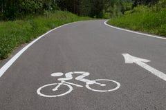 A estrada e o símbolo do ciclista Imagem de Stock Royalty Free