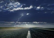 Estrada e relâmpago Imagens de Stock