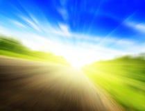 Estrada e sol do borrão de movimento Fotos de Stock Royalty Free
