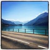 Estrada em torno do lago Imagem de Stock Royalty Free