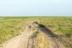 Estrada em um campo Fotografia de Stock