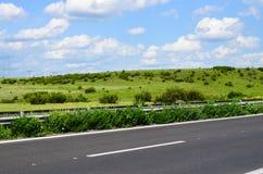 Estrada ensolarada Imagem de Stock Royalty Free