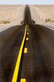 Estrada longa do deserto foto de stock royalty free
