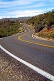 Estrada longa e curvy Fotos de Stock Royalty Free