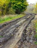 Estrada molhada da sujeira Fotos de Stock Royalty Free