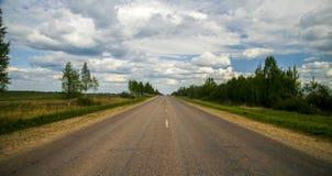 Estrada na floresta do verão Foto de Stock Royalty Free
