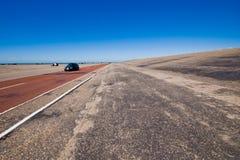 Estrada na paisagem estéril Foto de Stock Royalty Free