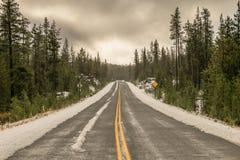 Estrada nevado Imagens de Stock