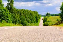 Estrada no campo Imagens de Stock
