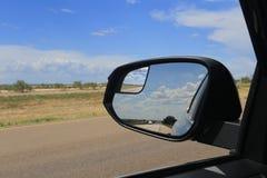 A estrada no espelho de RearView foto de stock royalty free