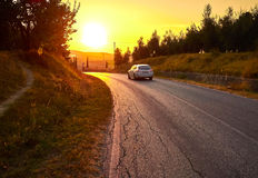Estrada no por do sol Foto de Stock Royalty Free