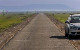 Estrada no prado Imagens de Stock