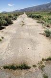 Estrada pavimentada abandonada fotografia de stock