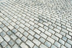 A estrada pavimentada com as pedras do godo para seu fundo Fotos de Stock