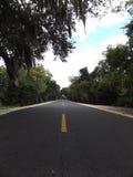 Estrada pavimentada pela água imagens de stock